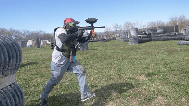 Man on the run playing paintball at Elite Sports Park